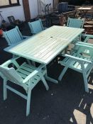 Large painted Garden table and six chairs, one chair A/F