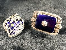 Two brooches of dark blue enamel one Heart shaped and the other rectangular