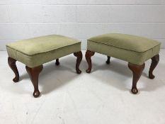 Pair of matching green upholstered foot stools on queen Anne legs