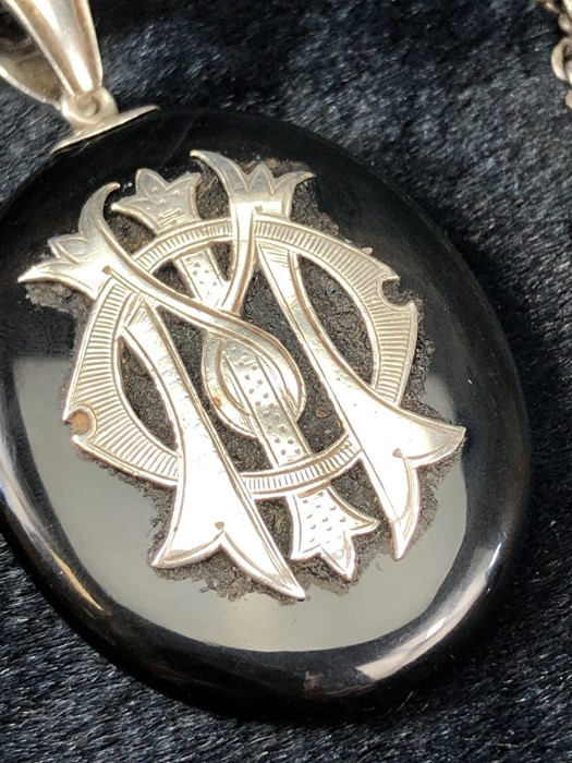 Lot 304 - Unmarked Victorian Mourning Pendant, approx: 45025mm x 36mm across Black Onyx with Applique entwined