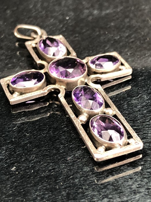 Lot 314 - Unmarked Silver Amethyst Cross, set with One round stone and 5 Oval stones. Measuring approx: