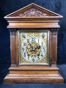 A Winterhalder & Hofmeier striking eight day mantel clock with silvered silent / chime, slow /