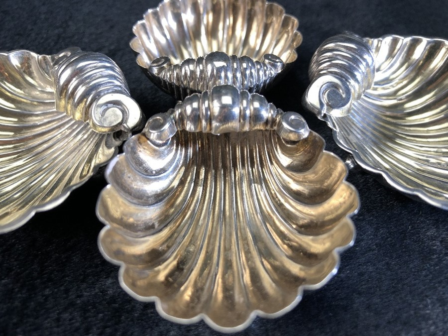 Lot 356 - A set of four silver hallmarked scallop shell shaped salts