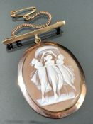 9ct Gold framed Cameo with 9ct Gold Bar and chain with window for picture to reverse