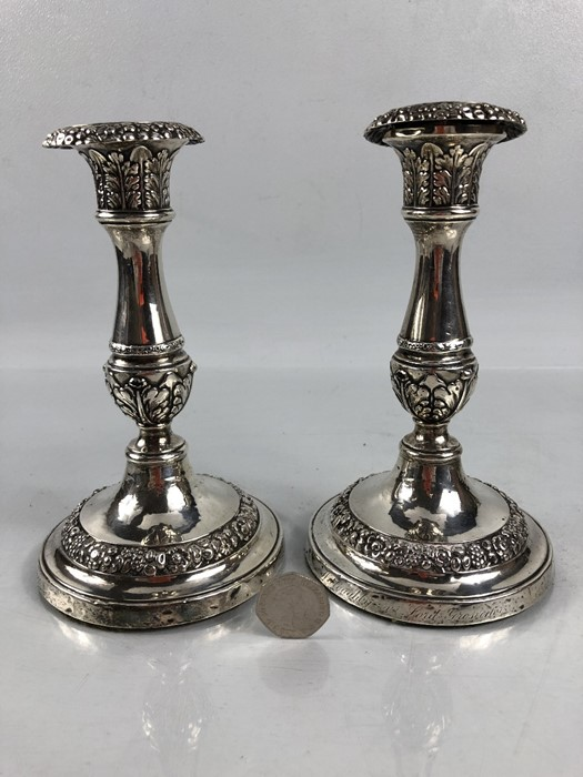"Lot 300 - Pair of Georgian Silver Hallmarked Candlesticks (A/F) both engraved to base ""Willoughby -v Lord"