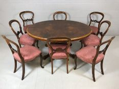 Victorian oval tilt top (with brass fittings) dining table (approx 110cm x 142cm) with book-
