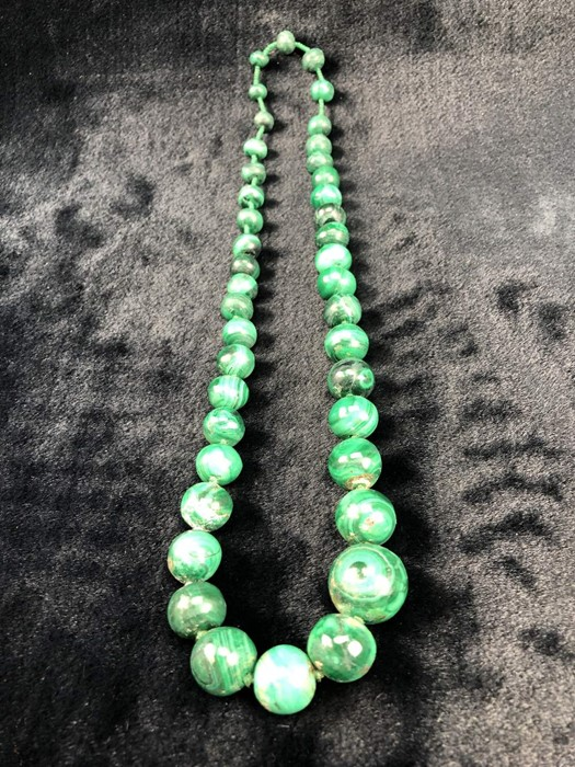 """Lot 307 - Measuring approx: 26"""" long (No Clasp) A Graduated string of Malachite Beads from 9.7mm to 22.4mm"""