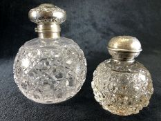 Two Glass perfume bottles with Birmingham hallmarked Silver lids and stoppers