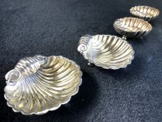 A set of four silver hallmarked scallop shell shaped salts