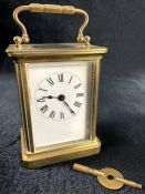 A 19thC brass carriage clock, of rectangular form with exterior swing handle, the rectangular dial
