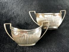 Pair of twin handled Silver Birmingham hallmarked salts 1905 by William E Turner (approx 55g)