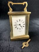 """An Edwardian brass timepiece carriage clock by John Castle of London, movement marked """"J"""" & """"F"""" with"""