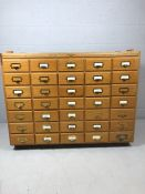 Haberdashery unit with thirty five pine matching drawers approx 44cm x 22cm x 9.5cm each, with metal