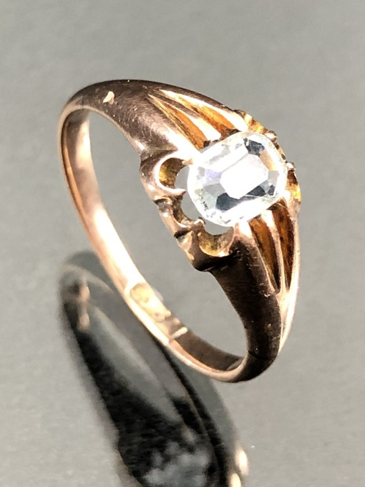 Lot 320 - 9ct Gold ring set with a cushion cut pale blue stone