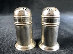 Hallmarked Silver Salt and Pepper pots Birmingham maker D&B with good blue glass liners