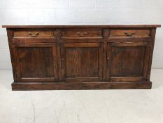 Large wooden modern sideboard with three drawers over approx 80 x 50 x 180cm