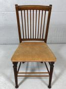 Small stained pine slat-backed childs chair with fine stretchers and turned front legs