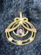 Gold Pendant with central Amethyst