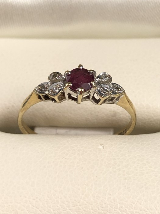 Lot 6 - 9ct gold ruby and diamond ring, approx size 'M.5'