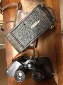 Kodak Brownie Junior - Model A in original leather case and a pair of Zenith binoculars