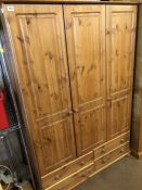 Triple pine wardrobe with four drawers under