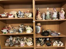 Large collection of ceramics and figurines over six shelves