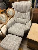 Upholstered swivel chair with matching footstool