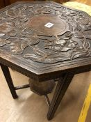 Carved occasional table in the Arts & Crafts style