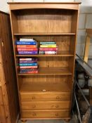 Modern bookcase with three drawers under