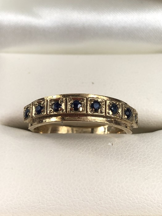 Lot 44 - 9ct Gold ring set with eight gemstones in square mounts