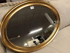 Large Gilt gold framed oval mirror