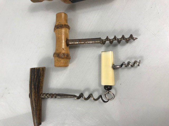 Lot 20 - VAT 69 bottle opener and three old corkscrews