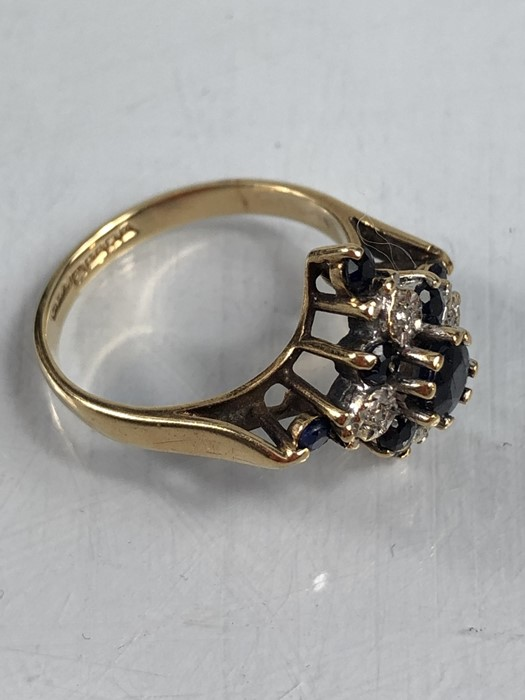 Lot 5 - 9ct gold sapphire and diamond ring, approx size 'K.5'