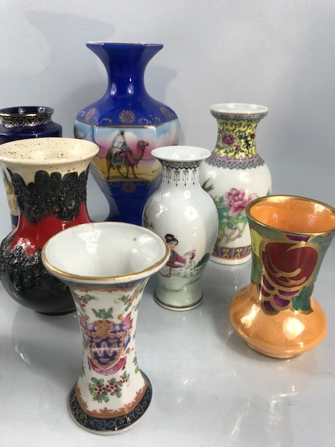 Lot 22 - Collection of nine posy vases to include West German lava vase