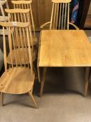 Ercol: Ercol Dining table and four blonde stick back mid century style chairs (one carver)