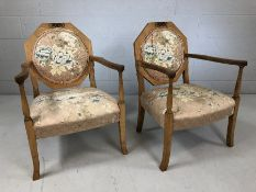 Pair of low upholstered bedroom carver chairs with floral motif (A/F)
