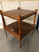 Two tier occasional table on Brass casters