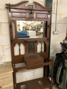 Arts and crafts hall stand with central copper plate and coat hooks