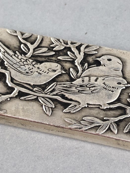 Lot 35 - Heavy Silver coloured Chinese scroll weight (aaprox 199g) decorated with Birds and stamped with