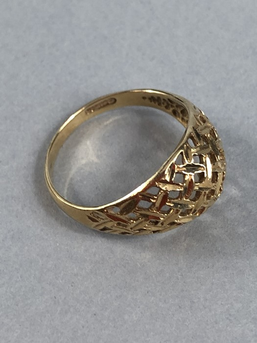 Lot 42 - 9ct Gold ring with Pierced decoration size L.5