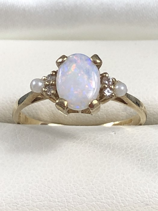 Lot 3 - 9ct gold opal and seed pearl ring