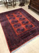 Red ground rug with blue detailing approx 230cm x 170cm