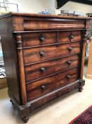 Victorian flame mahogany chest of six drawers with column detail on four bun feet