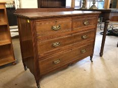 Chest of four drawers with brass handles on original castors and upstand, approx 107cm x 54cm x 83cm