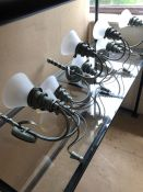 Four pairs of metal wall lights in pale green with glass shades