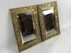 Pair of Victorian brass wall mirrors, one with repousse urn, garland and foliate scroll