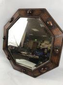 Octagonal wooden framed bevel edged mirror approx 55cm x 55cm
