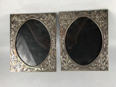 Pair of silver plated repousse photo frames approx 20cm x 25cm