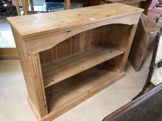 Pine bookcase with middle shelf approx 120cm x 34cm x 92cm tall