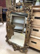 Contemporary ornate gold mirror approx 94cm x 55cm